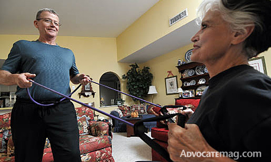 Trainer John Reeg works with client Glenda Cook, 74, who has lost 20 pounds since she started working out. Photo by Can Türkyilmaz