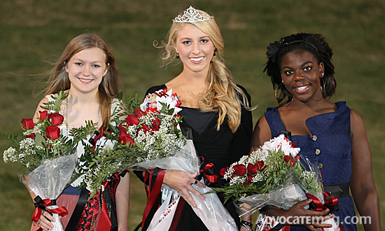 The Lake Highlands High School homecoming queen Sarah Penny (middle) and her court Rachel Lander (left) and Britta Myers (right) were crowned in a pre-game ceremony. David Werther snapped the photo.