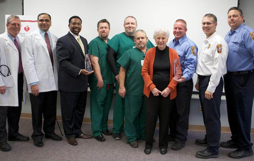 Jeanne Holms, pictured with Doctors Hospital and fire department personnel