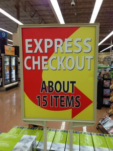 This Kroger sign leading to the express checkout lane seems kind of vague.