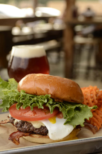 The coop burger at Goodfriend Beer Garden And Burger House comes with an over-easy egg, grilled bacon and brie. Photo by Mark Davis