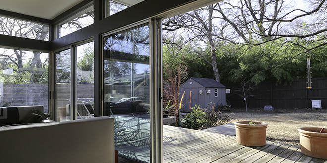 When opened, the sliding glass doors give the impression that the entire downstairs is actually a giant porch. Photo by Jeanine Michna-Bales