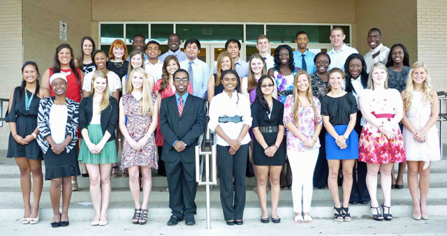 A group of Lake Highlands Women's League scholarship recepients from 2012, including Sarah Dossou (center, front).