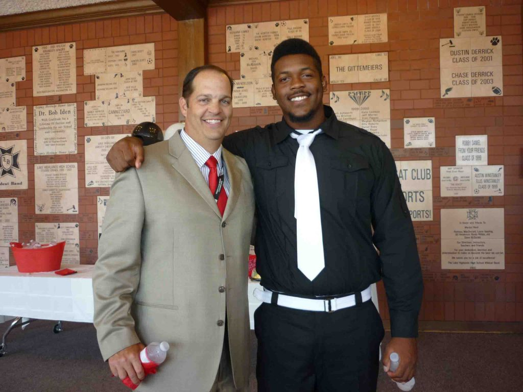 Scott Smith with LHHS player Kent Perkins in 2012. Perkins now plays at UT.