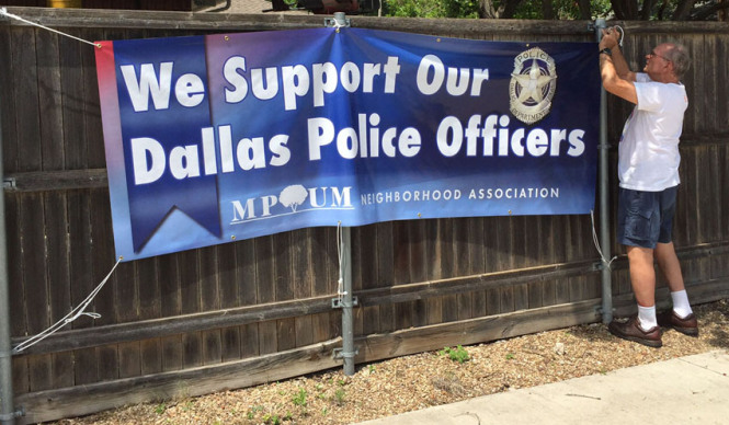Dallas Police Department photo of Lake Highlands residents posting a police appreciation banner.