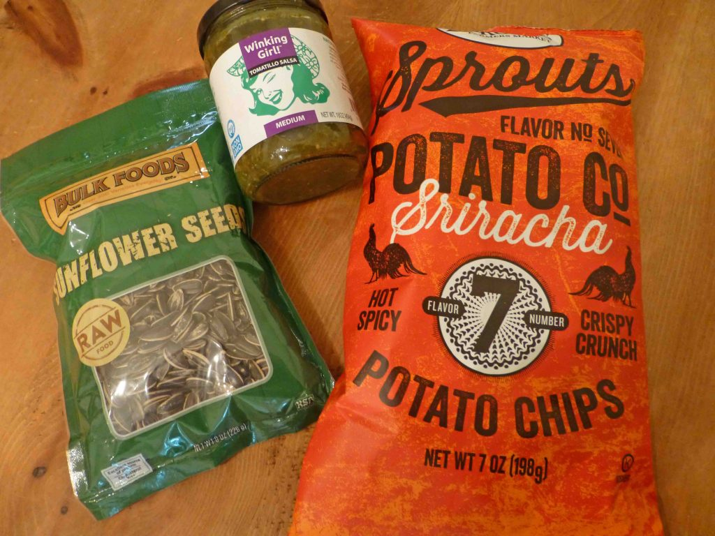 Sprouts label sunflower seeds, and Sriracha chips, Winking Girl salsa