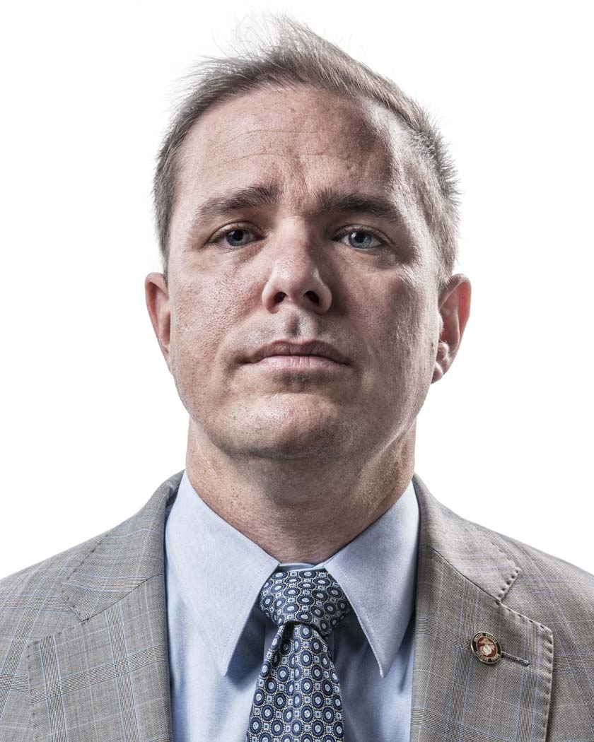 Jeff King poses for a portrait at his law office in downtown Dallas, TX on Oct. 2, 2015. Prior to his law career, King was a JAG officer in the United States Marine Corps. King saw combat in Iraq despite his designation for legal council and reparations to civilian populations. He continues to assist military veterans through his legal practice. Photo by Danny Fulgencio