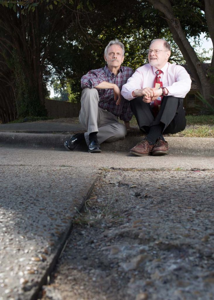 Richland College anthropology professor Tim Sullivan, and history professor Clive Sielge pose for a portrait at the Shoreview Road and Thurgood Lane intersection in Lake Highlands. The pair collaborated in teaching their respective courses surrounding Little Egypt, a post-Civil War community that existed on the boundaries of where they sit. Photo by Rasy Ran