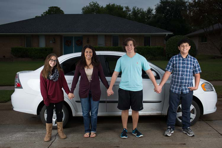 From left: Sara, Teresa, Samuel and Matthew Hendricks pose for a photo outside their Plano home November 1, 2015. The family lost their father who had a car repair accident in the garage. The Hendricks were gifted a brand new Chevy Aveo for Samuel by former Dallas Cowboys' Bradie James and Terence Newman. (Photo by Rasy Ran)