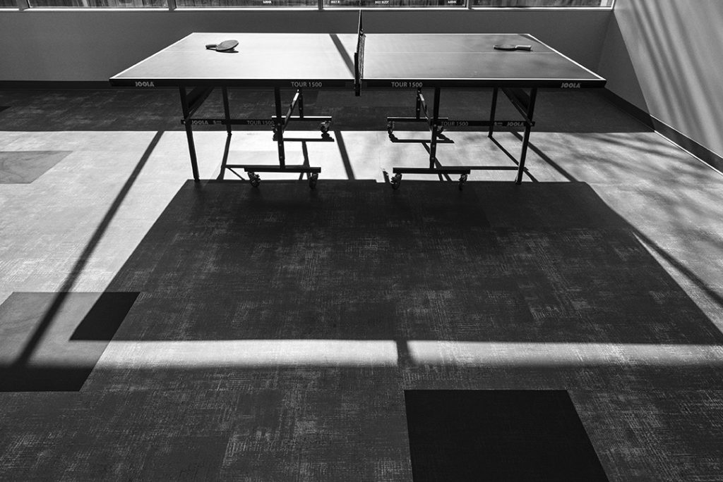A teen hang-out room offers ping pong and other games.