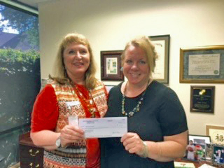 Healing Hands founder Janna Gardner with Regina Sobieski, Director of the North Texas Specialty Physicians Charitable Fund.