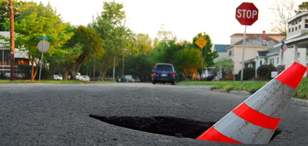 pothole with caution cone