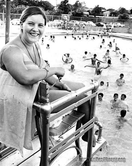 A happy lifeguard and swimmers at McCree Park pool in May 1969. (From the collections of the Dallas History & Archives Division, Dallas Public Library)