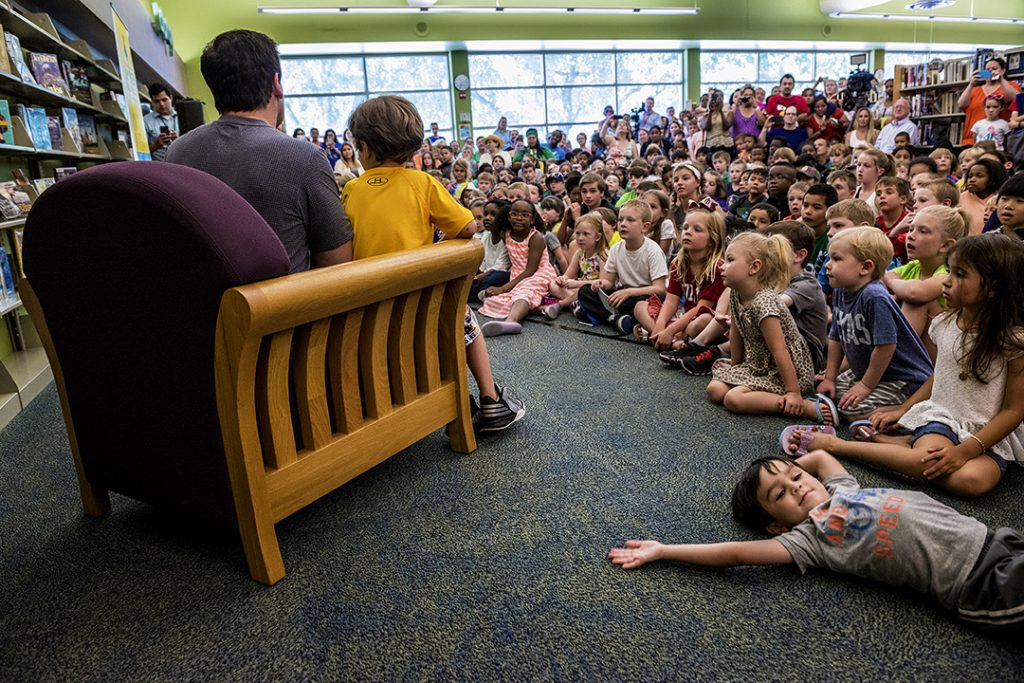 DALLAS, TX 06/07/2016 Entrepreneur and philanthropist Mark Cuban, along with his son, Jake Cuban, read books a gaggle of children at the Audelia Branch Library in Dallas, TX on June 7, 2016 as part of the Mayor's Summer Reading Club, an initiative to get kids reading during the summer months. Credit: Danny Fulgencio