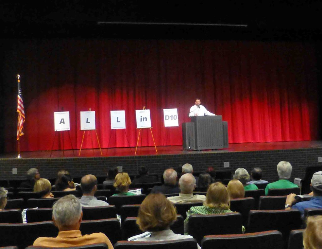 Dallas City Councilman Adam McGough conducts Tuesday night's Town Hall meeting