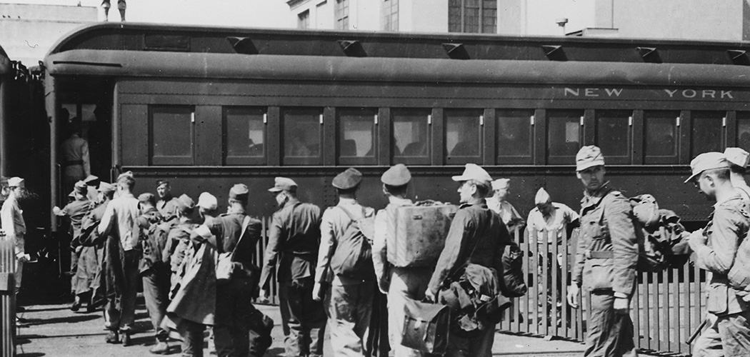 German prisoners of war enter a train car at Mexia in Texas. Some 200,000 German P.O.W.s were housed in Texas from 1943-45. Below, German P.O.W.s were paid 80 cents per day in canteen coupons. (Images courtesy of the Friends of Camp Hearne)