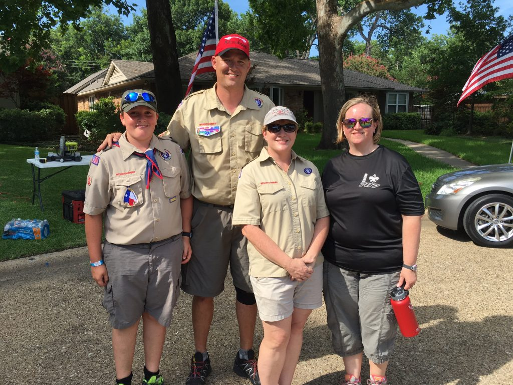 Members of Boy Scout Troop 707 gather to post flags near police station