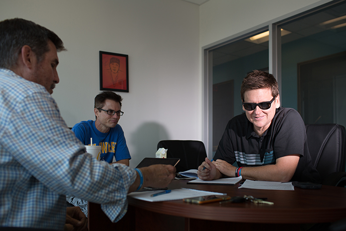 ESPN radio personality Matt Mosley, right, runs through a pre-show meeting with Tim Cowlishaw and Tom Gribble before their afternoon session. (Photo by Rasy Ran)