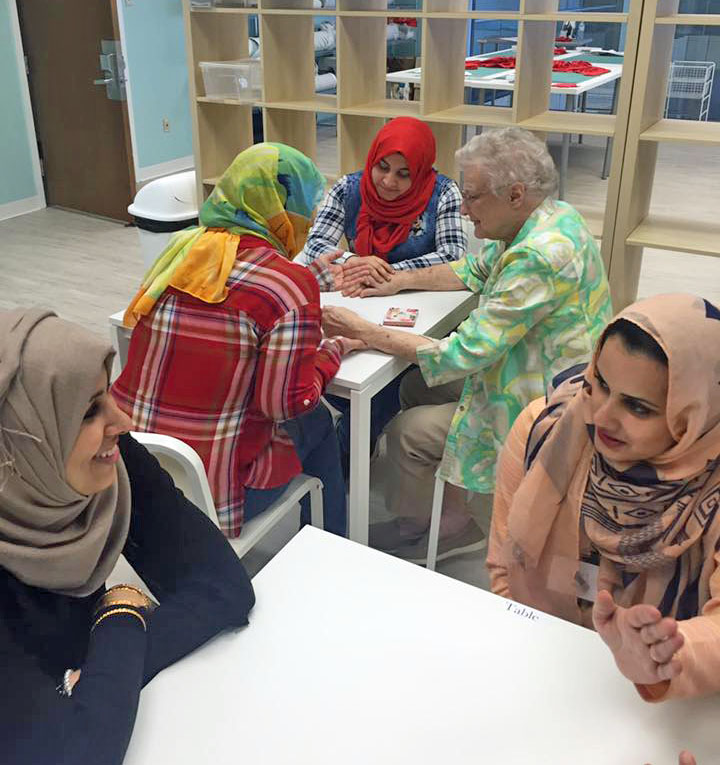 Refugee women with a mentor at Vickery Trading Company