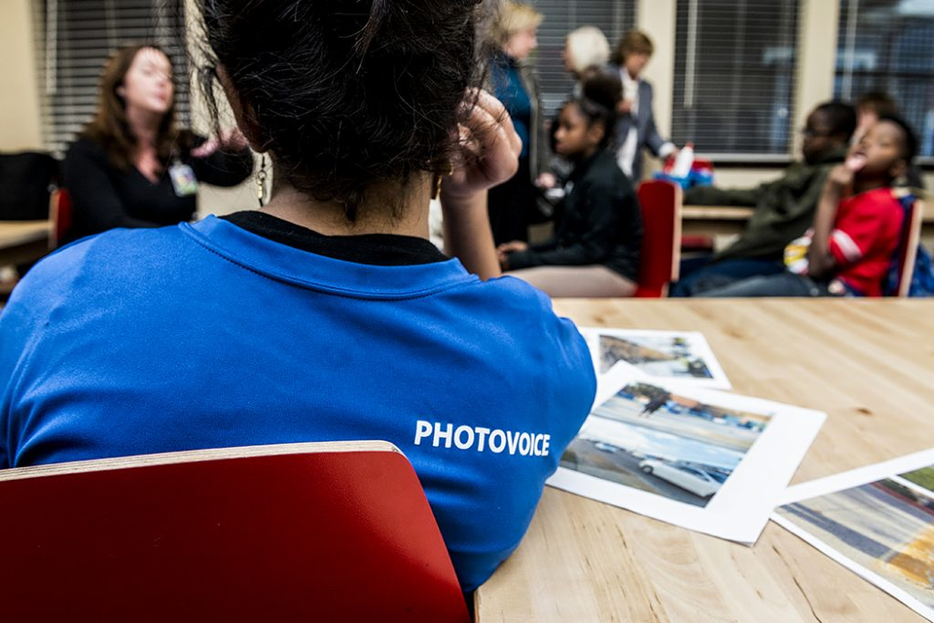 Volunteers teach students photography and social action through PhotoVoice. Photo by Danny Fulgencio