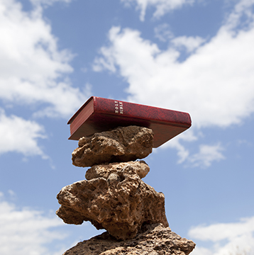 Bible on stack of stones for balance concept
