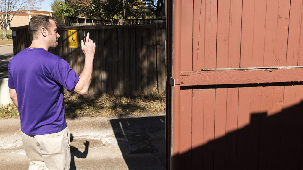 Andre Lanaux shows where he chased the teenage intruder into the alley. (Danny Fulgencio)