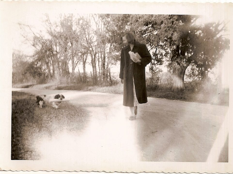 """Alice Dahman, whose family owned the land that later became Skyline Park. She's pictured here with Laddie, """"the only dog who could carry the newspaper in,"""" says relative Cindy Dahman Johnson. (Photo courtesy of Cindy Dahman Johnson)."""