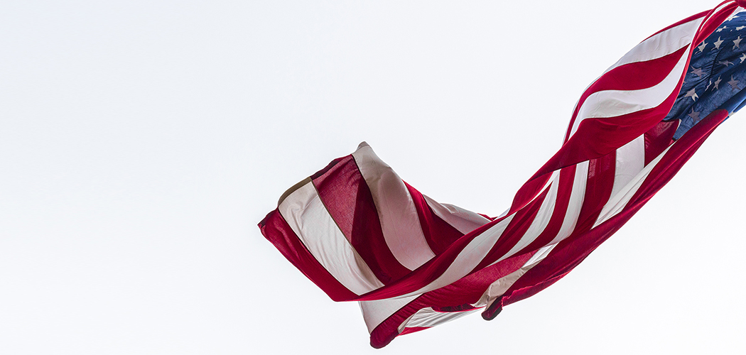 American flag in the wind Flagpole Hill. Photo by DannyFulgencio