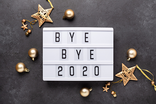 Lightbox with text BYE BYE 2020 with gold decoration on dark background. Top view. New year celebration. Happy New Year 2021 concepts - Image