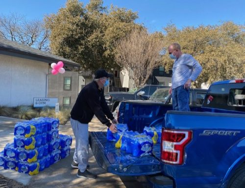 Kids-U donates 1,500 water bottles to Lake Highlands apartment community without water